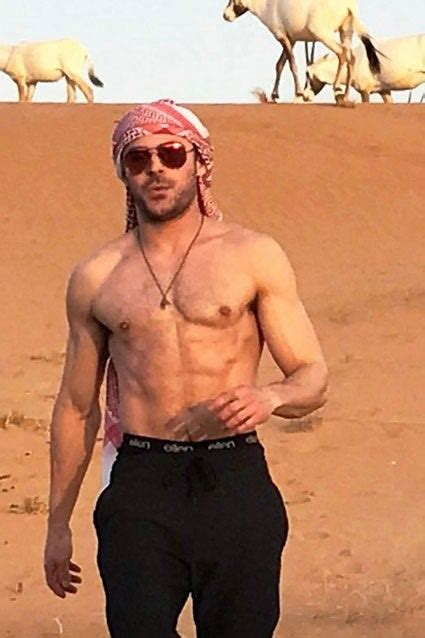 Zac Efron Rides a Camel Shirtless in Dubai -- See the